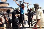 Christians being crucified by ISIS